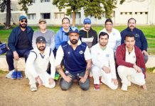 Winning team players and dignitaries posing for a group photograph at KC Sports Ground in Jammu.
