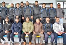 Selected wrestlers posing for a group photograph along with Divisional Sports Officer, Ashok Singh at Jammu.