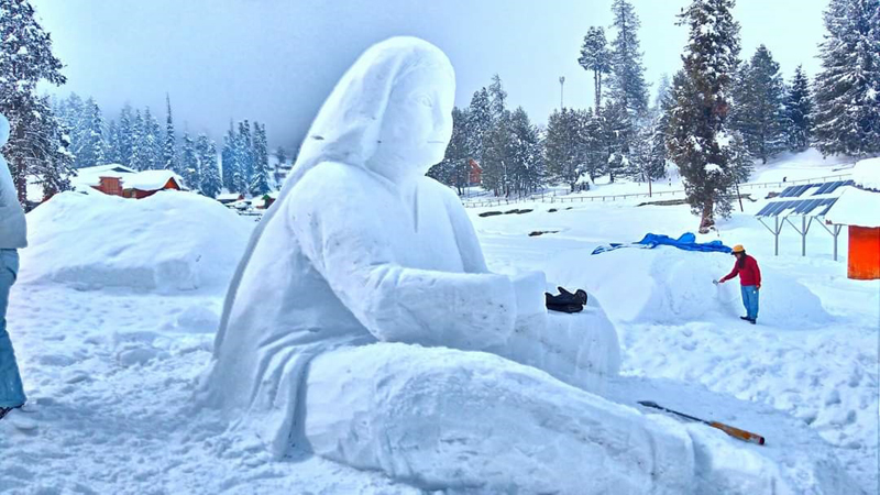 A snow sculpture of a woman made by an artist during the competition at Gulmarg.