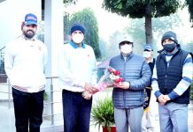 Dignitary being awarded with bouquet at Jammu.
