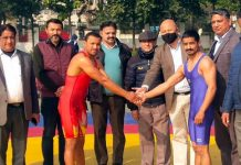 Wresters and dignitaries posing for a group photograph during inaugural ceremony at Gulshan Ground Jammu.