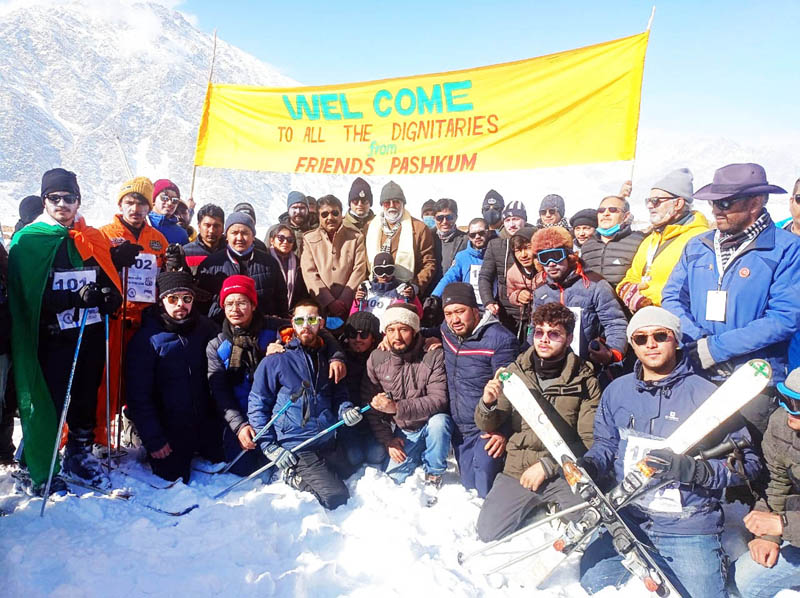Union Tourism Minister, Prahlad Singh Patel posing photograph with players and dignitaries at Kargil on Sunday. -Excelsior/ Basharat Ladakhi