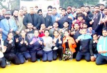 Advisor Farooq Khan posing for a group photograph with winning wrestlers at Jammu on Saturday.