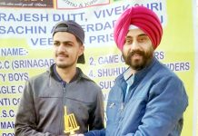 Player being awarded with man of the match trophy at Jammu.