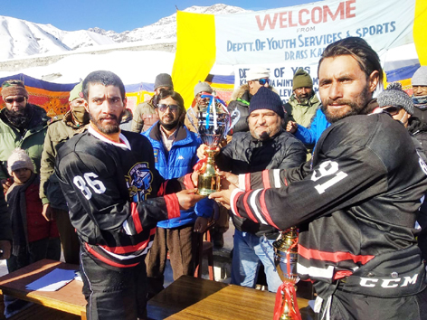 Chief guest presenting trophy to the winning team players at Kargil on Wednesday.