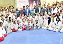 Medal winners pose with distinguished guests at the valedictory function at Bhagwati Nagar, Jammu on Thursday.