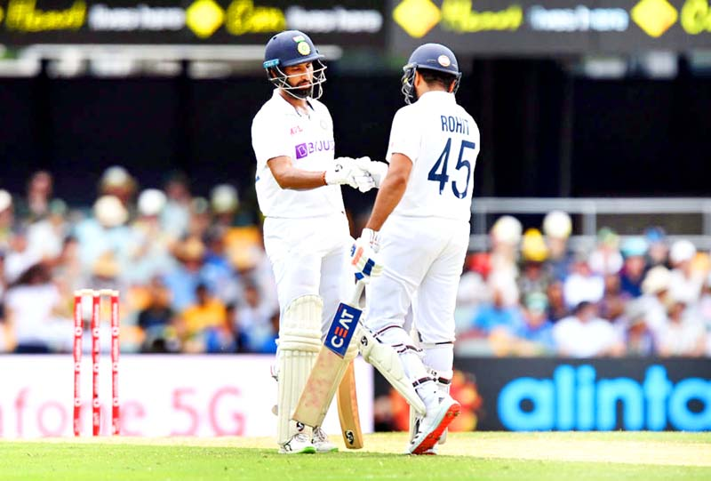Indian opening batsmen interacting with each other during first inning of fourth Test against Australia on Saturday.