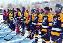 Players posing for group photograph during inagural ceremony of Ice Hockey tournament at Kargil on Wednesday.