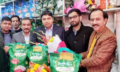 Officials of Double Heart Basmati Rice posing for a group photograph at Jammu on Wednesday.
