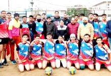 Winning Volleyball team posing for group photograph with dignitaries at Jammu.