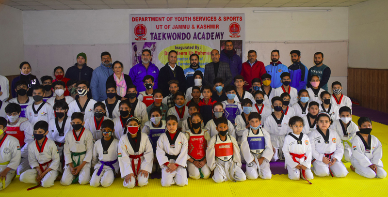 DG YSS, Saleem-Ur-Rehman posing for a group photograph with Taekwondo players at Khel Gaon Nagrota on Tuesday.