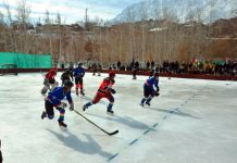 Players in action during a match of District Level Ice Hockey Tournament at Kargil. -Excelsior/Basharat Ladakhi