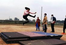 A player in action during high jump event at Govt College for Women Gandhi Nagar Jammu.