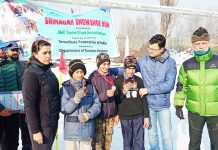 Winners of SnowShoe events displaying their medals at Srinagar.