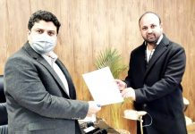 DDC member, Shahnawaz Choudhary presenting memorandum to Commissioner/ Secretary, Sarmad Hafeez on Wednesday.