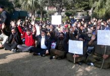 Home Guards staging a sit-in protest outside Raj Bhavan on Wednesday.