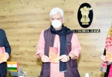 Lt Governor Manoj Sinha releasing book of Dr Abdul Ghani on Monday.