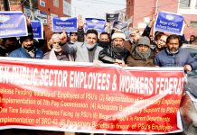 J&K public sector employees and workers staging protest in Srinagar on Tuesday. -Excelsior/ Shakeel