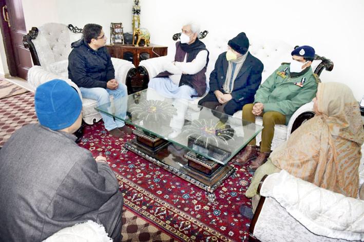 Lt Governor Manoj Sinha meeting family members of slain goldsmith Satpal Nischal at Srinagar.
