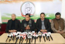 J&K Congress spokesperson Ravinder Sharma addressing a press conference at Jammu on Saturday.