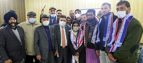 Apni Party president Altaf Bukhari & others alongwith new entrants during a function at party office in Jammu.