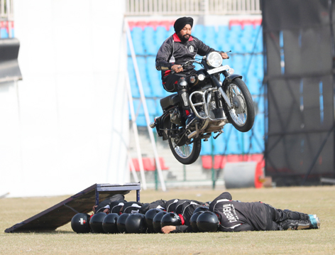 A biker displays stunt during full dress rehearsal of Republic Day parade at MA Stadium in Jammu on Sunday. —Excelsior/Rakesh