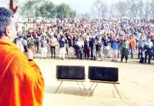 BJP J&K UT president, Ravinder Raina addressing a party rally at Lamberi, Nowshera on Sunday.