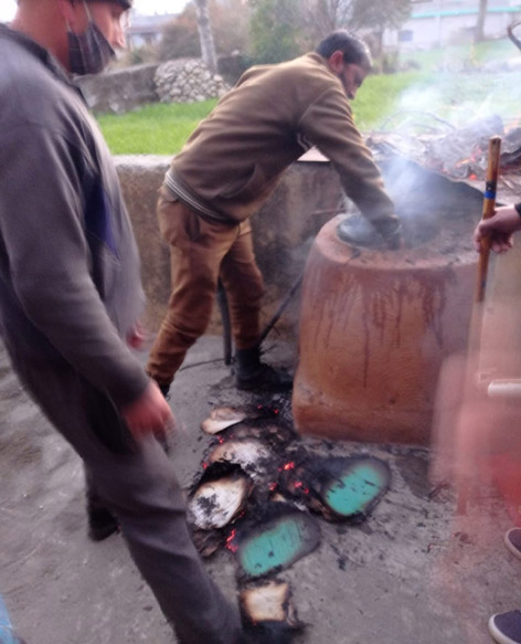 Half burnt files of BDO office Darhal being recovered by police from a burning clay oven.