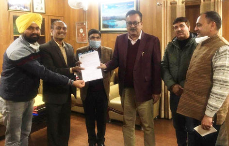 Prof Ganesh S Hingmire, Chairman of the consultancy group presenting the copy of GI application to Naveen Choudhary, Principal Secretary APD in the presence of officers on Wednesday.
