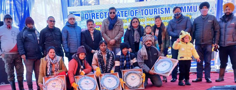 Officials and tourists posing for photograph during winter carnival at Patnitop.
