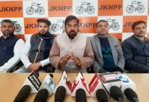 NPP chairman flanked by others addressing press conference in Jammu.