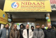 SP ACB Ravel Singh and others posing in front of Nidaan Diagnostics' new collection centre at Greater Kailash, Jammu.