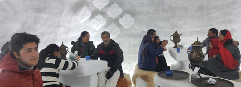 Tourists having dinner inside snow Igloo cafe in Gulmarg. —Excelsior/Aabid Nabi