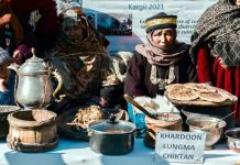 Women presenting traditional dishes during Ladakh's ethnic Mamani festival.