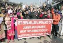 Empanelled ReT aspirants protesting in Jammu on Monday. —Excelsior/Rakesh