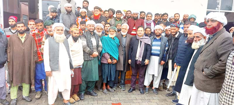 Tribal researcher Javaid Rahi with members of Gujjar-Bakerwal community during awareness campaign in Samba on Sunday.