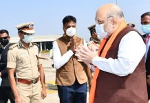 Karantaka Water Resources Development Minister Ramesh Jarkiholi and Deputy Commissioner M G Hiremut welcoming Union Home Minister Amit Shah at Sambra Airport in Belagavi on Sunday. (UNI)