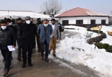 Advisor Baseer Khan conducting tour of Srinagar city on Monday.