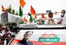 Congress Leader, Rahul Gandhi addressing at the roadshow during his campaign for forthcoming Assembly Elections, in Coimbatore on Saturday. (UNI)
