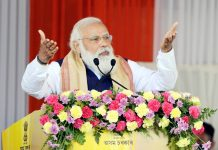 Prime Minister Naredra Modi delivering speech after distributing land patta to landless people during the public meeting at Jerenga Pathar, Sivasagar District of Assam on Saturday.(UNI)