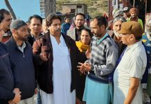 Senior Congress leader, Raman Bhalla interacting with people at Belicharana in Jammu on Tuesday.