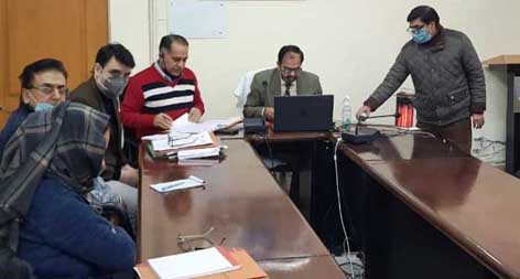 JKPCB Chairman Suresh Chugh chairing a meeting on Monday.