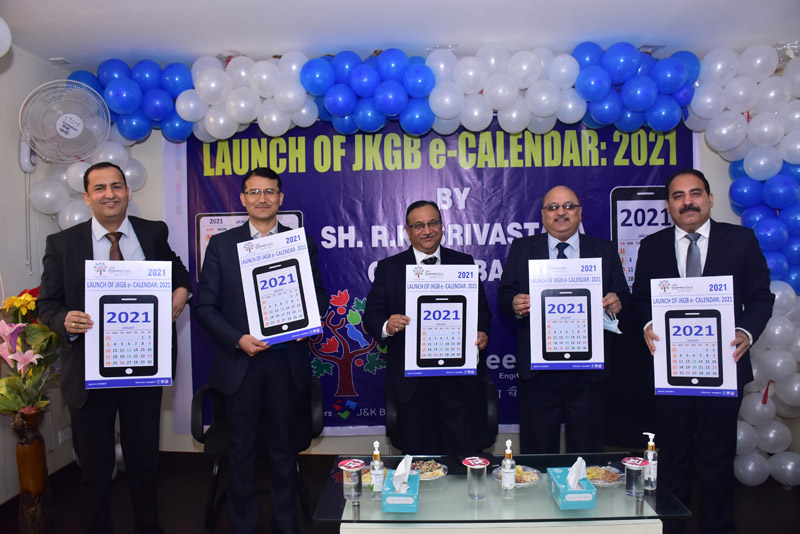 CGM NABARD RK Srivastava along with senior officers of NABARD and J&K Bank unveiling e-Calendar for the year 2021.