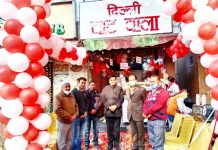 JMC Mayor Chander Mohan Gupta posing with proprietors of food outlet 'Delhi Chat Wala' after inaugurating the outlet in Green Belt Park, Gandhi Nagar. The outlet has been opened by Raghav Goswami and Lalit Thakur, who said that they will serve the tasty chat of Delhi in Jammu while maintaining the quality standards.