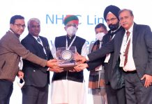 RP Goyal, Director (Finance), NHPC alongwith other senior NHPC officers receiving the winner's trophy from Union Minister Arjun Ram Meghwal.