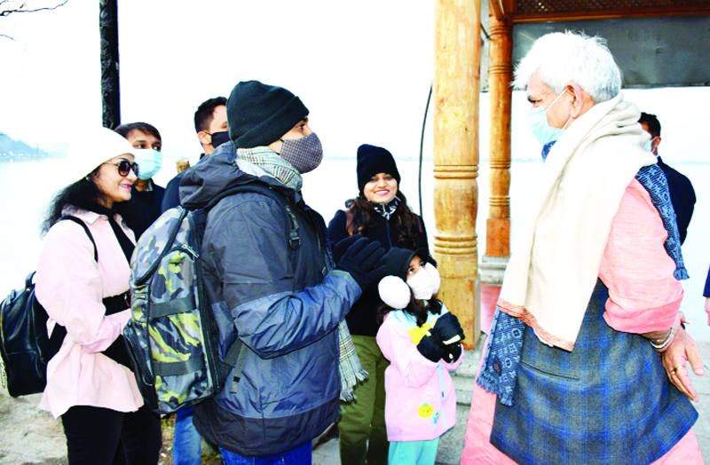 Lieutenant Governor Manoj Sinha interacting with tourists in Dal lake of Srinagar on Tuesday.