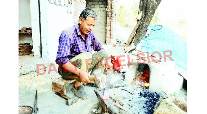 A person working to make tools in Reasi. -Excelsior/Karandeep Singh