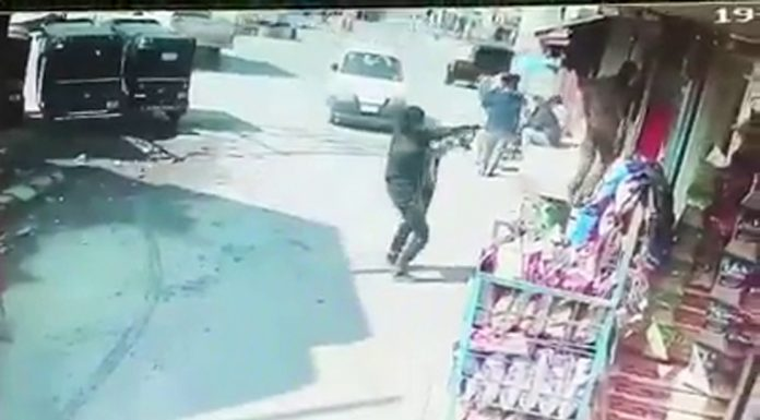 A militant is seen in CCTV footage firing at police personnel in Baghat area of Srinagar on Friday.