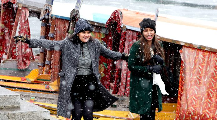 Tourists enjoying fresh snowfall in Srinagar. -Excelsior/Shakeel
