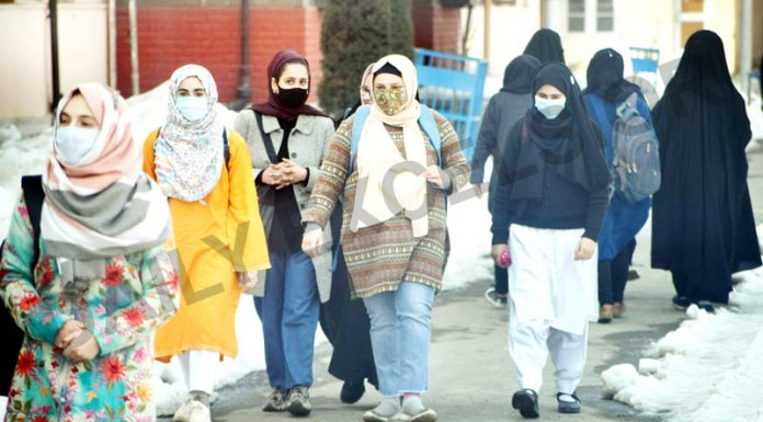 Students walk inside a campus as colleges reopen since COVID pandemic in Srinagar on Monday. -Excelsior/Shakeel